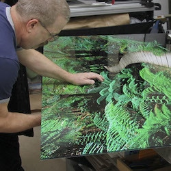 Blow Up employee preparing print for installation