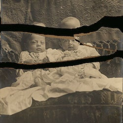 photo of a damaged antique photograph of babies