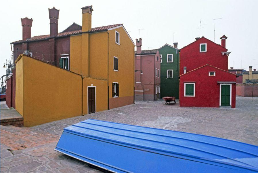 Photograph by Roberto Soncin Gerometta of Lagoon of Venice, Italy, a quiet square of the colorful Island of Burano.