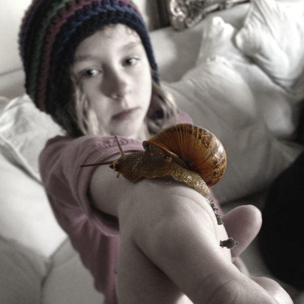 Instagram photo of Little Girl With Snail