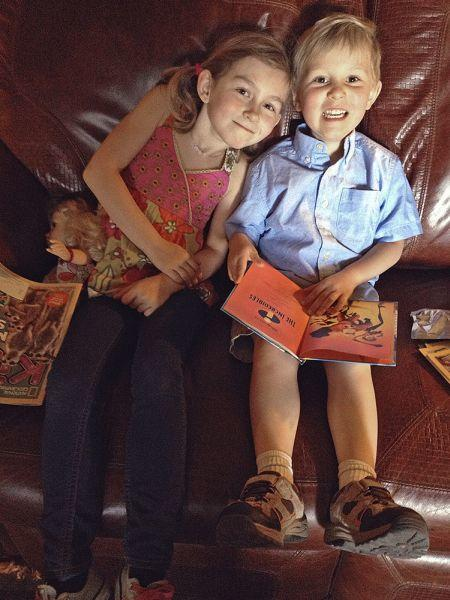 Snapshot of a Boy and Girl sitting on Couch smiling