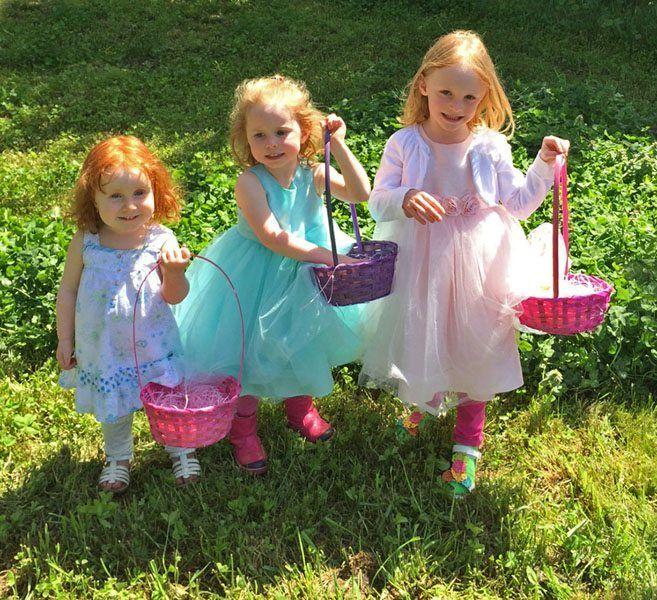 Family Photo of Three Little Girls on Easter Egg Hunt