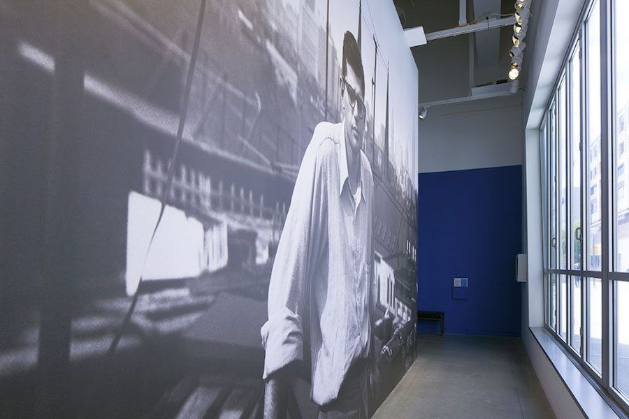 Photo of Allen Ginsberg as big mural at the CJM