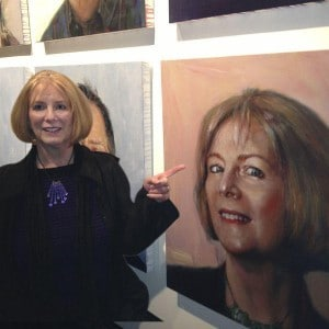Carol Covington in front of portrait of herself by Valentin Popov