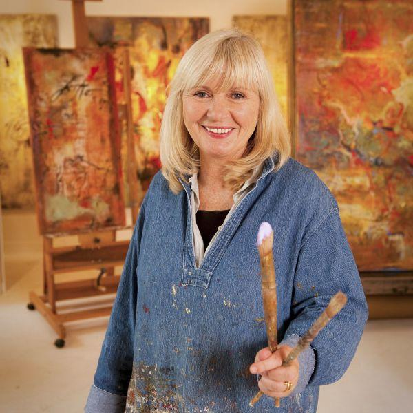 Dominique Caron Holding Paint Brushes